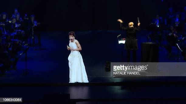 This AFP TV video frame grab shows the hologram of Maria Callas singing on stage during an hologram-concert at the Salle Pleyel, in Paris, on...