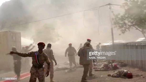 This AFPTV screen grab from a video made on August 1 shows Yemeni security forces rushing at the scene of a missile attack on a military camp west of...