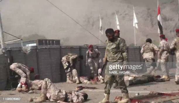 This AFPTV screen grab from a video made on August 1 shows Yemeni security forces looking for survivors at the scene of a missile attack on a...