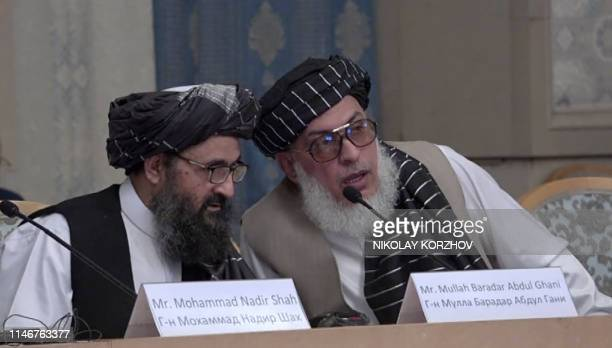 This AFPTV screen grab from a video made on May 28 2019 in Moscow shows Mullah Abdul Ghani Baradar and Stanikzai Sher Mohammad Abbas Abbas Afghan...