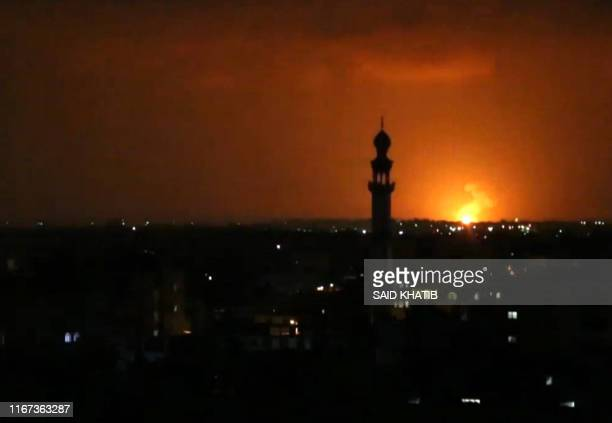 TOPSHOT This AFPTV screen grab from a video made on September 11 shows a view of an explosion from an Israeli air strike near Deir elBalah in the...