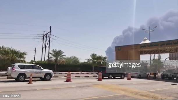 TOPSHOT This AFPTV screen grab from a video made on September 14 shows smoke billowing from an Aramco oil facility in Abqaiq about 60km southwest of...