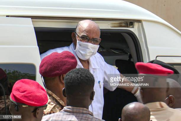 This AFPTV screen grab from footage aired July 21 2020 shows Sudan's ousted President Omar alBashir disembarking from a vehicle upon arriving at the...