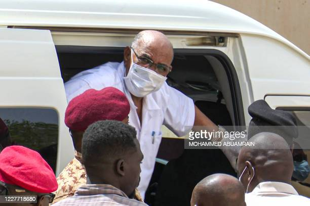 TOPSHOT This AFPTV screen grab from footage aired July 21 2020 shows Sudan's ousted President Omar alBashir disembarking from a vehicle upon arriving...