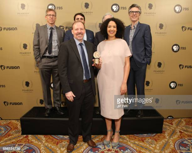This American Life Anatomy of Doubt producers Joel Lovell Brian Reed Ken Armstrong Bill Keller Robyn Semien and Ira Glass pose with an award during...