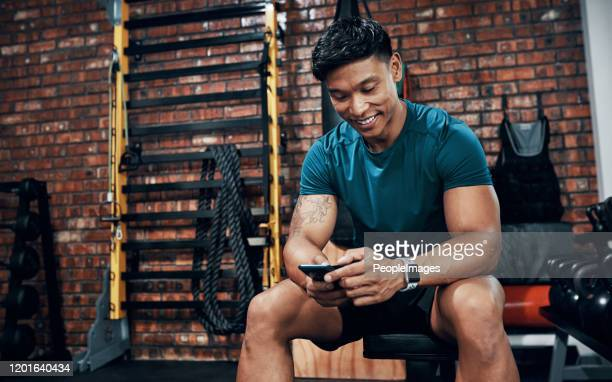 this app is like my own personal trainer - gym stock pictures, royalty-free photos & images