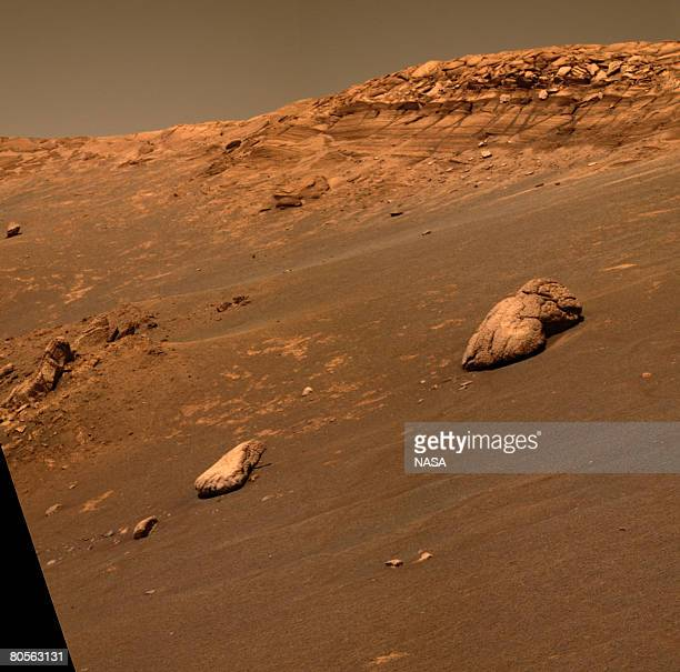 This approximate truecolor image taken by NASA's Mars Exploration Rover Opportunity shows an unusual lumpy rock informally named Wopmay on the lower...