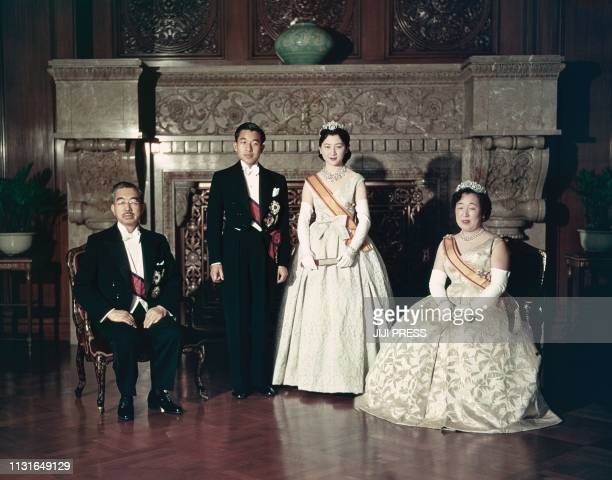 This April 10 1959 picture shows Japan's Emperor Akihito and Empress Michiko posing for a photograph with Emperor Hirohito and Empress Nagako after...