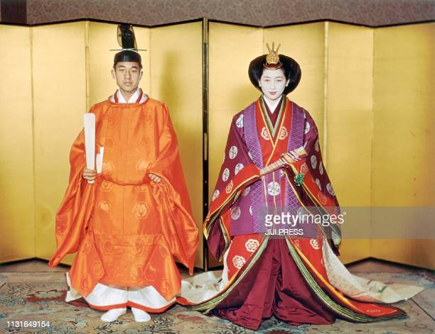 This April 10 1959 picture shows Japan's Emperor Akihito and Empress Michiko posing for their wedding at the Kashiko Dokoro in Imperial Palace in...