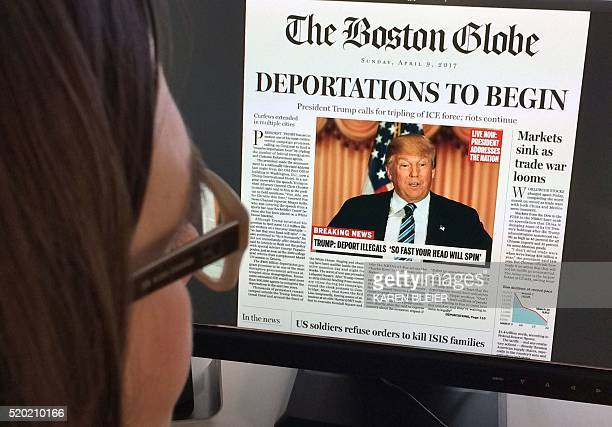 TOPSHOT This April 10 2016 photo taken in Washington shows a woman reading an online version of a mockup of what a frontpage might look like should...