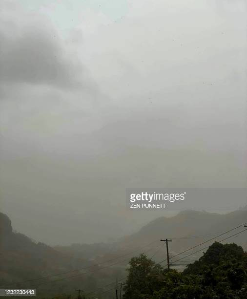 This April 10 image courtesy Zen Punnett shows ash clouds from the eruption of La Soufriere Volcano from Rillan Hill in Saint Vincent. - Ash covered...