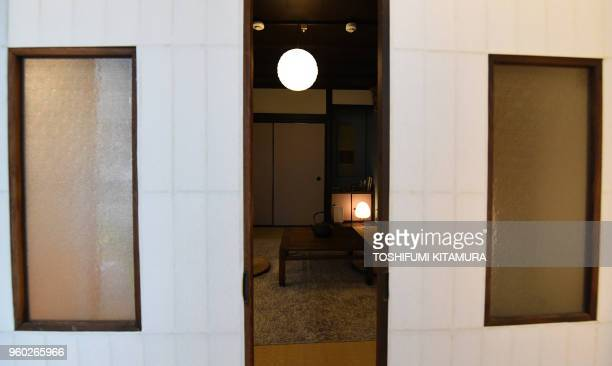 This April 16 2018 picture shows a Japanese traditional tatamimat room in shortterm accommodation operated by Hyakusenrenma's rental house in Tokyo...