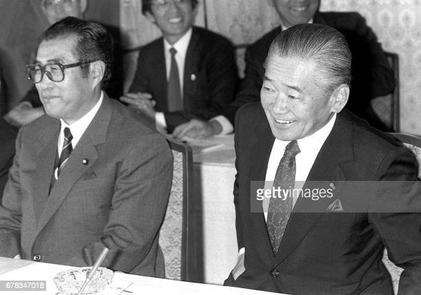 This April 1988 file picture shows former Japanese Prime Minister Noboru Takeshita and Keizo Obuchi Chief Secretary of Takeshita's cabinet at the...