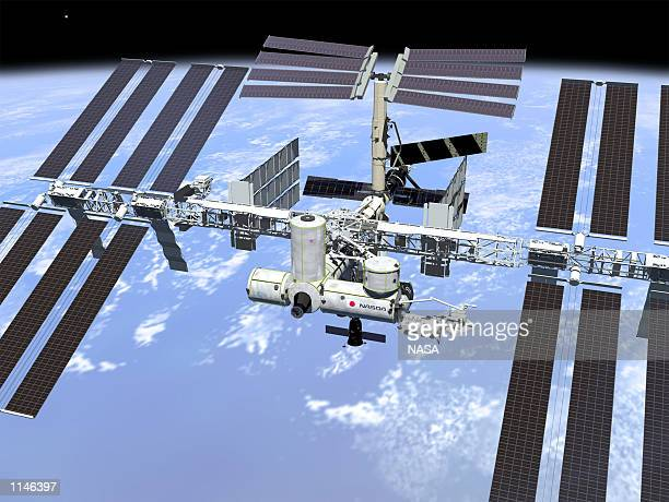 This artist's concept shows the International Space Station when its assembly sequence is completed in 2004, including minor changes to the final...