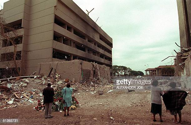 This August 1998 file picture shows Kenyan residents looking at the US embassy days after the bomb blast that killed at least 280 kenyans and 12...