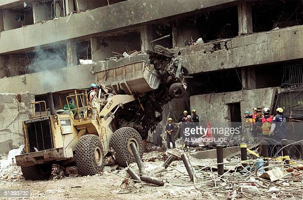 This August 1998 file picture shows Police workers removing the remains of the carbomb used to destroy the US embassy in Nairobi 07 August 1998 that...