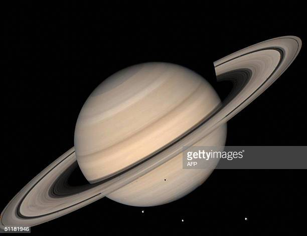 This August 1998 NASA file image shows a true color photo of Saturn assembled from Voyager 2 spacecraft Three of Saturn's moons LR Tethys050 km in...