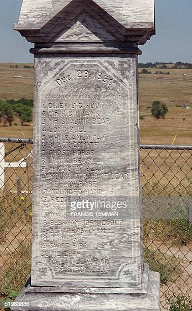 This August 2001 photo shows a monument at the burial site of Lakota Native Americans killed in the 29 December 1890 massacre by US Army soldiers at...