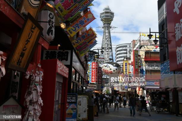 This August 8 2018 picture shows the landmark Tsutenkaku tower at the Shin Sekai shopping district in Osaka city a neighbour city to Higashiosaka one...