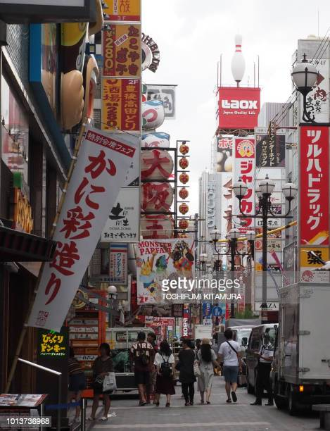 This August 9 2018 picture shows Dotonbori shopping district in Osaka city a neighbour city to Higashiosaka one of the host cities of the next 2019...