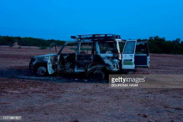 This August 9, 2020 image shows the wreckage of the car where six French aid workers, their local guide and the driver were killed by unidentified...
