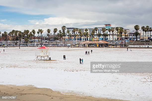 This beach city blanked in what looks like snow.