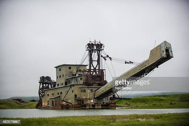 This behemoth relic is a reminder of the gold dredging days of Nome, Alaska. These bucket dredges plowed through the earth and operated 24 hours a...