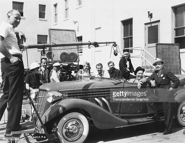 This behindthescenes photograph shows cameramen and the entire crew pausing for group photo Hollywood California circa 1940
