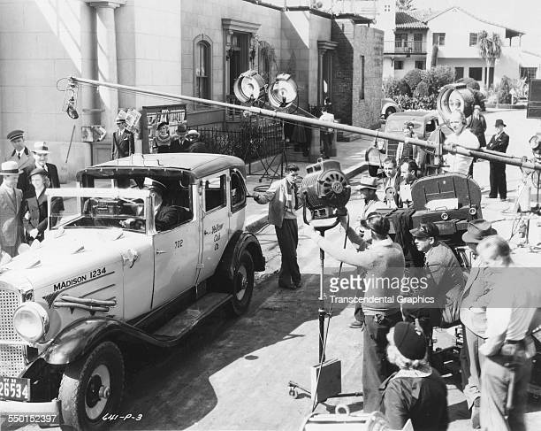 This behindthescenes photograph shows cameramen and the entire crew setting up a scene Hollywood California circa 1940