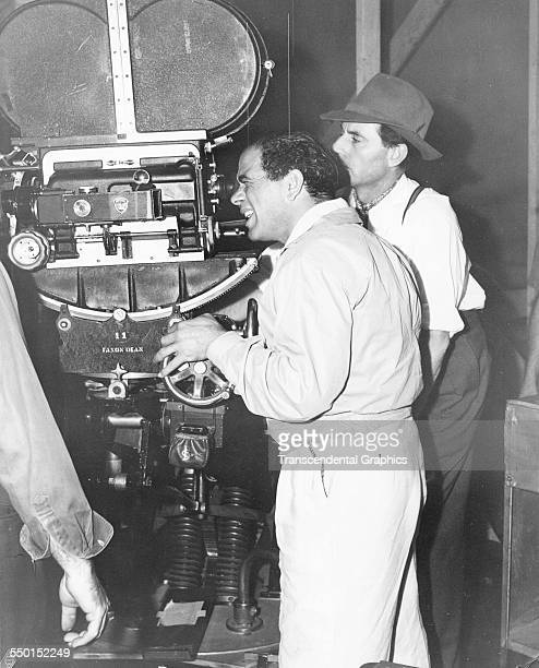 This behindthescenes photograph shows film director Frank Capra working the camera on the set Hollywood California circa 1940