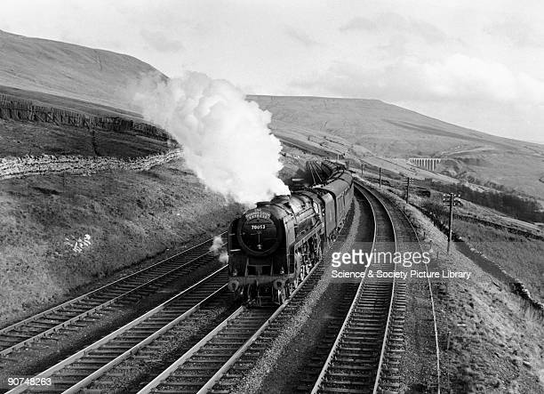 This Britannia Class locomotive is seen here with the northbound ThamesClyde Express having just passed through Dent Station Cumbria Photograph by...