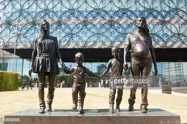 This bronze sculpture of a 'Real Birmingham Family' by artist Gillian Wearing, was unveiled in front of the Library of Birmingham in 2014. Sisters &...