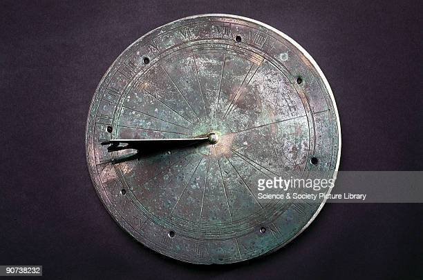 This bronze sundial has the initials WB inscribed on it It was possibly made by Thomas Gemini of London who made timepieces for Queen Elizabeth I...