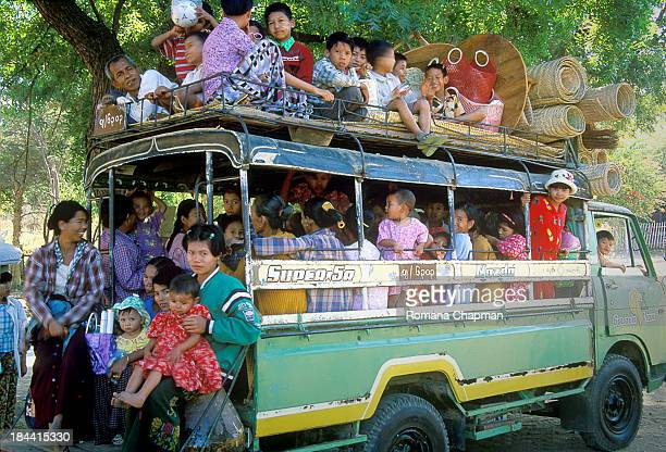 This bus was still waiting for more passengers to join before making the trip worthwhile for the driver. Animals, people and cargo all share the...