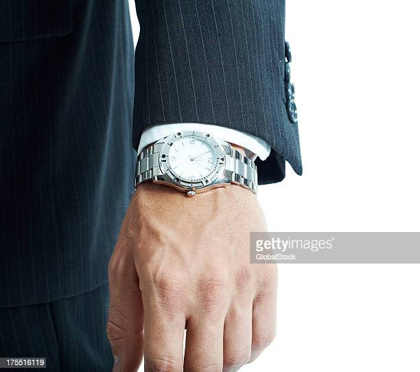 this businessman is never late - wrist watch stock pictures, royalty-free photos & images