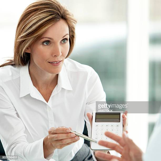 This businesswoman is a persuasive Financial Advisor