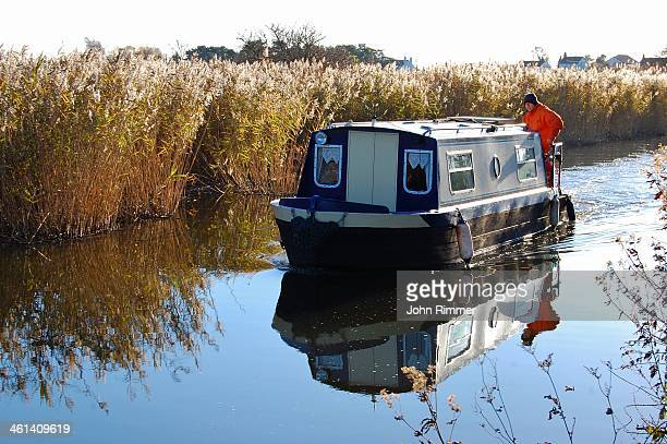 This canal boat was cruising peacefully along the Leeds Liverpool Canal near Halsall, West Lancashire on a crisp late Autumn day.