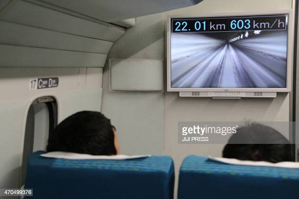 This Central Japan Railway hand out picture shows passengers watching a monitor in the company's sevencar maglev short for 'magnetic levitation'...