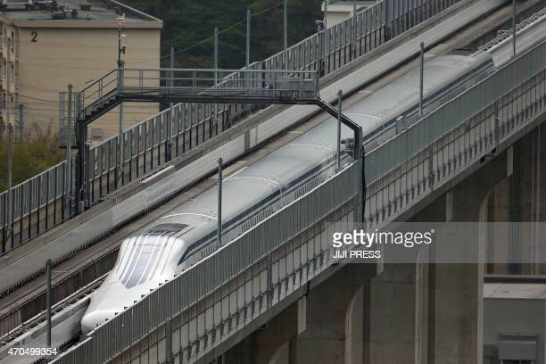 This Central Japan Railway hand out picture shows the company's sevencar maglev short for 'magnetic levitation' train setting a new world speed...