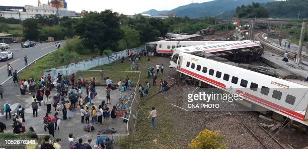 This CNA handout picture taken on October 21 2018 shows a derailed train in Yian eastern Taiwan At least 17 people have died after a train derailed...