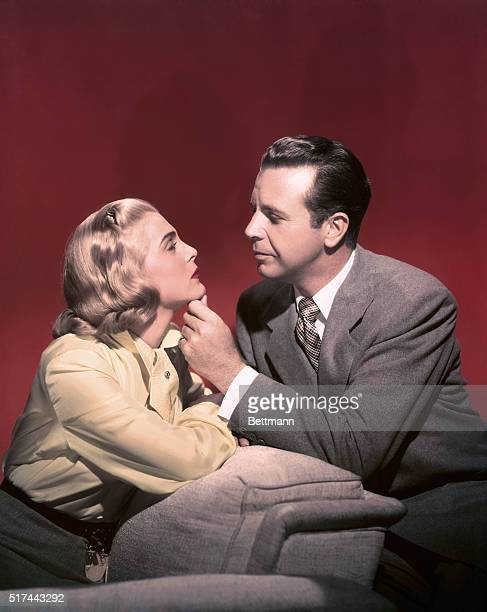 this color photo of Dick Powell and Lizabeth Scott shows the players as they appear in their costarring roles in Samuel Bischoff's Regal Films...