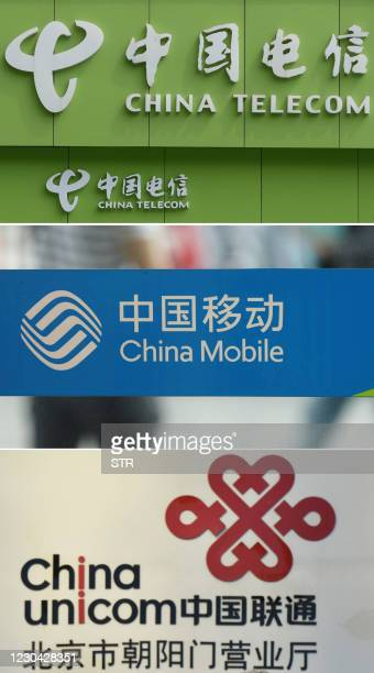 This combination of file photos shows the logo of China Telecom at a store in Wuhan on August 21, 2013; the logo of China Mobile at an office in...
