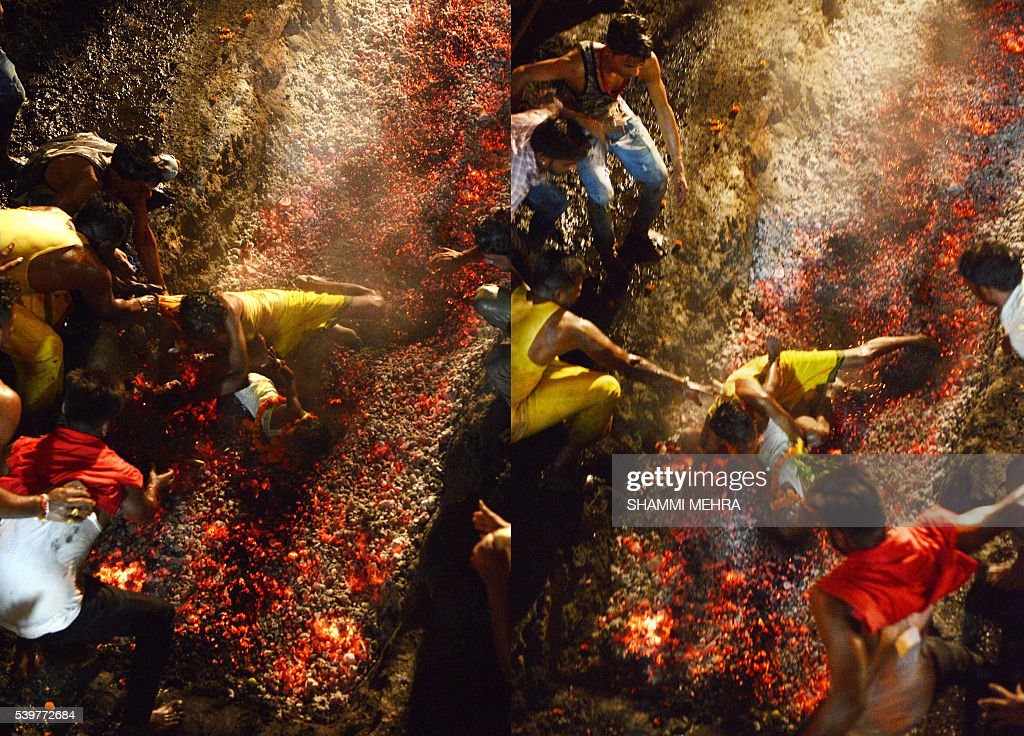 This combination of photographs shows an Indian Hindu devotee dropping his sixyearold son Kartik as he falls while running on burning coals at the...