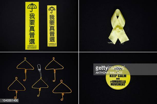 This combination of pictures created and taken on September 25 2018 shows items created and given out during Hong Kong's 2014 Umbrella Movement...