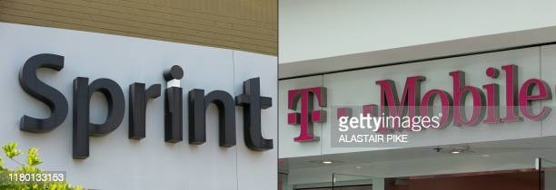 This combination of pictures created on November 5, 2019 shows The Sprint logo seen outside a shop in Washington, DC, on July 26, 2019. And The...