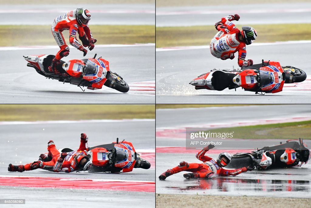 This combination of pictures created on September 10, 2017 shows Ducati Team's Spanish rider Jorge Lorenzo falling from his bike during the San Marino Moto GP Grand Prix at the Marco Simoncelli Circuit in Misano, on September 10, 2017. / AFP PHOTO / Marco BERTORELLO