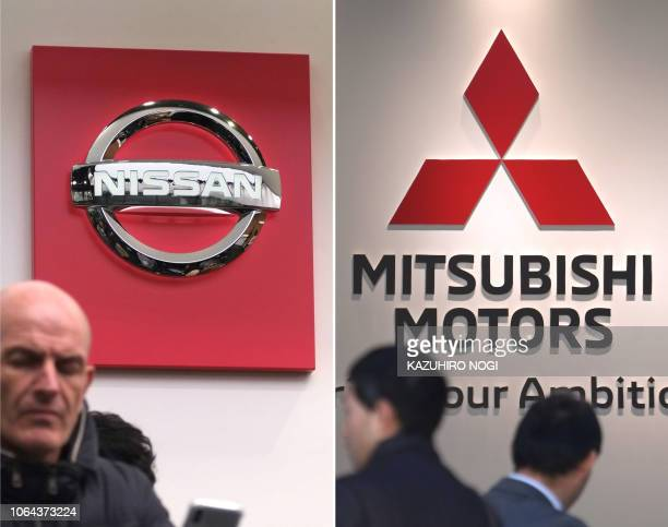 This combination photo shows shows the logo of Nissan Motor and Mitsubishi Motors at their company's showroom in Tokyo on November 23, 2018. -...