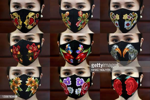 This combination photograph shows a model posing in designer Do Quyen Hoa's colourful hand-embroidered face masks, used as a preventive measure...