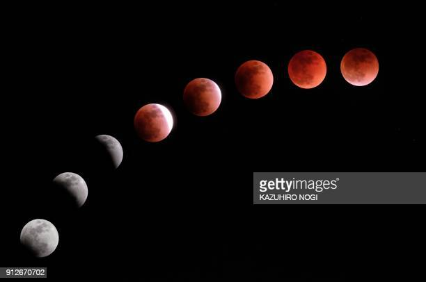 TOPSHOT This composite image created on January 31 2018 shows the moon during a lunar eclipse referred to as the 'super blue blood moon' in Tokyo...