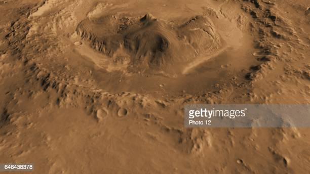 This computergenerated view based on multiple orbital observations shows Mars' Gale crater as if seen from an aircraft north of the crater